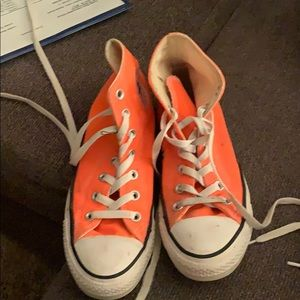 Bright orange high top Converse